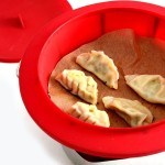 Dim sum dumplings in Norpro red silicone steamer insert